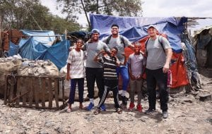 """Kentucky football players, from left, Jamar """"Boogie"""" Watson, Calvin Taylor and Landon Young brought a lot of smiles to children in Ethiopia during a recent mission trip with UK Athletics and Ordinary Hero. (UK Athletics Photo)"""