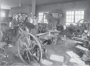 "IN EARLIER DAYS — According to column appearing in the June 23, 1949 edition of The Mountain Eagle, the newspaper was preparing to celebrate its 43rd birthday on June 30, 1949. The Eagle will finish its 112th year of operation on Sunday, June 30, 2019. In the photo above, discarded pages of newsprint litter the floor in what was then The Mountain Eagle's new home. The Eagle moved into the ""Jail Street"" location, behind the Letcher County Courthouse, now known as Broadway Street, sometime in the early 1930s. The column, a birthday-related history of the paper, appears below right."