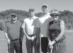 Finishing in third place in the Whitesburg Rotary Club/Letcher County Chamber of Commerce Golf Scramble consisted of, from left, Billy Long, Duran Sparkman, Chris Stewart and Joan Curry.