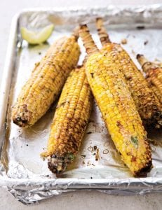 """This photo provided by America's Test Kitchen shows Mexican Street Corn from recipe in the cookbook """"The New Essentials Cookbook."""""""
