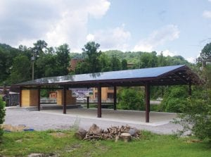 Solar collectors on Appalshop's new outdoor music pavilion, designed by local architect Bill Richardson, are expected to save the organization $100,000.