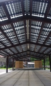 SHINING THROUGH — Solar collectors on the roof of the new music pavilion at Appalshop reflect the sky. Inside, sunlight filters through the collectors, keeping it shady, but light, and supplying up to 70 percent of the electricity Appalshop needs. (Photos by Sam Adams)