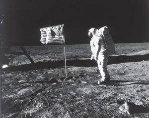 In this image provided by NASA, astronaut Buzz Aldrin poses for a photograph beside the U.S. flag deployed on the moon during the Apollo 11 mission on July 20, 1969. Television is marking the 50th anniversary of the July 20, 1969, moon landing with a variety of specials about NASA's Apollo 11 mission. (Neil A. Armstrong/NASA via AP)