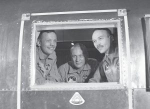 In this July 27, 1969 file photo, Apollo 11 crew members, from left, Neil Armstrong, Buzz Aldrin and Michael Collins sit inside a quarantine van in Houston. (AP Photo)