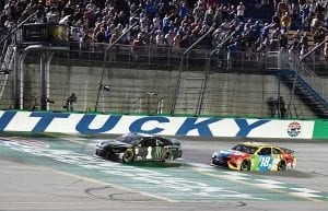 Kurt Busch crosses the finish line ahead of Kyle Busch (18) to win the NASCAR Cup Series auto race at Kentucky Speedway in Sparta. (AP Photo)