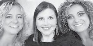 Lori Thomas, Elizabeth Trotter Cooper and Lindsey Stamper Combs celebrate Lindsey's birthday.