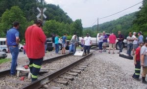 Blackjewel miners played cornhole on the railroad tracks near Cumberland on Tuesday while family members and supporters walked the picket line with them.