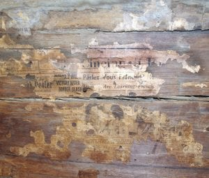 OLD NEWS – This 1936 edition of the Cincinnati Post was used as wallpaper on a wall inside of Artie Ann Bates's 1875 log house near Blackey. (Photo by Sam Adams)