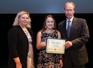 Lonnie Lawson, right, president and CEO of The Center for Rural Development, and Allison Cross, left, youth programs coordinator for The Center, present 2019 Rogers Scholars graduate Emma Bates with a certificate for completing the program. She is a junior at Letcher County Central High School.