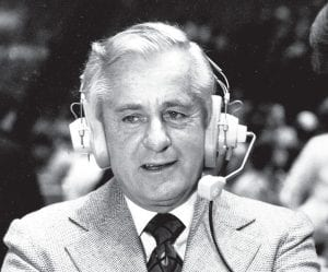 In this Sept. 15, 1978, file photo, Curt Gowdy, the dean of network sportscasters, wears a headset. A versatile announcer nicknamed the Cowboy who started off as Mel Allen's partner on Yankees radio broadcasts, Gowdy was one of the original voices of the AFL on ABC when the league started in 1960. He moved on to NBC in 1965 and was in the booth for some of the most memorable games in pro football history. (AP Photo)