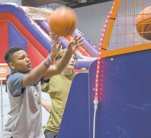 Martese McGowan shoots hoops in one of the arcade games at the Jenkins Wellness and Fun Center during Saturday's grand opening. (Photos by Chris Anderson)