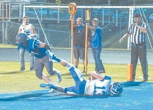 Letcher Central's Zach Hensley falls to the ground in the end zone with control of the ball to put up two extra points in Friday's opening week matchup at Shelby Valley.