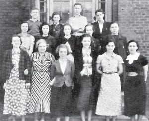 GLEE CLUB — (Left to right, front row) Alice Smith, Opal Land, Florence Auxier, Ruth Holbrook, Mary Alley, Mrs. Mary Harmon (Director), (middle row) Odell Johnson, Maywood McKinney, Ada Lee Pace, Kathleen Reed, Morine Dale, (back row) Robert Preston, Loreen Keesee, Raymond Hall, and Clyde Flanery.