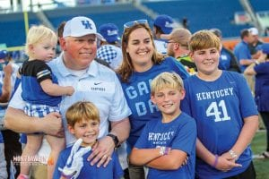 """Kentucky assistant coach John Schlarman's battle with cancer the last year has not been easy for anyone but his wife has tried to keep things as """"normal"""" as possible for everyone despite her constant worries. The coach and his family pictured here. (Mont Dawson Photo)"""