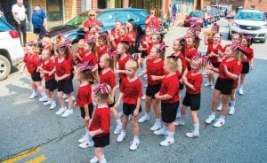 The Martha Jane Potter Tweets cheerleading squad shows their school spirit during Saturday's Neon Days parade.