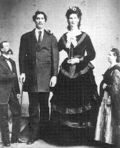 Letcher County native Martin Van Buren Bates, second from left, posed with his wife, Anna Swann of Nova Scotia. The couple, whose June 1871 marriage was sponsored by Queen Victoria of England, met on the carnival circuit in New Jersey. Bates stood at 7 feet, 8 inches tall, about 3-1/2 inches shorter than his wife.