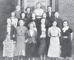 GLEE CLUB — From left to right are (front row)Alice Smith, Opal Land, Florence Auxier, Ruth Holbrook, Mary Alley, Mrs. Mary Harmon (Director (middle row) Odell Johnson, Maywood McKinney, Ada Lee Pace, Kathleen Reed, Morine Dale (back row) Robert Preston, Loreen Keesee, Raymond Hall, and Clyde Flanery.