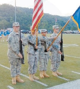 COLOR GUARD — Friday night, the Letcher County Central JROTC Color Guard performed for the high school homecoming. This four-cadet color guard was led by LTC Isaiah McCall carrying the U.S. flag, carrying the state flag was 2 LT Hannah Taylor, carrying the rifles were (left) CPT Steven Collins and (right) CPT Randy Shepherd.