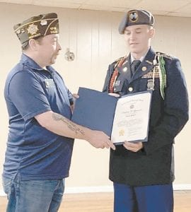 JROTC Commander LTC Isaiah McCall of the Letcher County Central High School JROTC performed the POW/ MIA Ceremony for VFW Post 5829 in Whitesburg at its quarterly district meeting. LTC McCall received a Certifi- cate of Appreciation from the VFW District Commander.