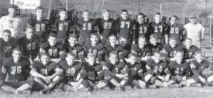 1951 YELLOWJACKET FOOTBALL TEAM — (First row, left to right) Willis Caudill, Bob Harvey, Burky Holbrook, Jamie Hale, Buddy Fields, Jim Enlow, Bobby Kincer, Jimmy Wampler, Bobby Adams, (second row) Jimmy Morse, Sidney Slemp, Sammy Banks, Doug Polly, Ralph Palumbo, Harold Ison, David Kincer, F.C. Hammonds, Jimmy Bert Tolliver, Jack Fairchild, (third row) Coach Ray Pigman, Don Nolan, Jack Adams, Bobby Combs, Truman Combs, Ivan Hall, Bobby Breeding, Eddie Collins, John Rufus Hall and Assistant Coach John Dill Brown.