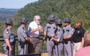 Bennett Combs, father of the late Kentucky State Trooper Bennett David Combs, talks with troopers during a ceremony naming the overlook on US 23 for his son. Pictured (left to right) are Captain Jennifer Sandlin, Trooper Brandon Watts, Mr. Combs, Trooper Michael Burton, Lt. Jackie Joseph, Trooper Bruce Kelly, and Detective Scott Caudill.