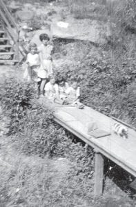Madonna Taylor Whipple, Jo Ella Taylor Sturgill, Sharon, are shown with cousins Joyce and Jimmy Holbrook.