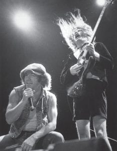 "First Top 40 hit boosts AC/DC On October 25, 1980, the Australian hard rock band AC/ DC earned their first pop Top 40 hit with ""You Shook Me All Night Long."" As The History Channel points out, ""AC/ DC would never have another single as popular as 'You Shook Me All Night Long,' but the group's ongoing ability to sell full-length rock albums — even in an era when digital downloads have decimated album sales across all genres— is utterly without parallel."" … According to the Recording Industry Association of America, AC/DC rank as the 10thhighest selling recording artists of all time with 71 million albums sold — 30 million fewer than Led Zeppelin, but roughly five million more than both the Rolling Stones and Aerosmith and nearly 15 million more than both Metallica and Van Halen. Pictured above, AC/DC vocalist Brian Young and lead guitarist Angus Young perform in the early 1980's. (AP Photo)"