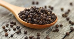 Peppercorns are seen in this photo. Ground peppercorns add a much-needed boost to the mild flavors of chicken, pork and fish.