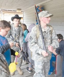 Letcher County JROTC Cadets Elijah Roark and Blake Hogg enjoy the general store at the Battle of Leatherwood.