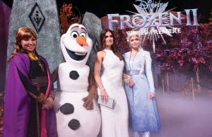 "Idina Menzel, second right, posed with characters from ""Frozen 2,"" from left, Anna, Olaf and Elsa, as she arrived at the film's world premiere at the Dolby Theatre in Los Angeles. (Invision/AP)"
