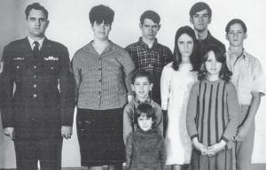 The Vanover family posed for a passport photo before leaving for Lindsey Air Station in Wiesbaden, Germany, and Everett Vanover's new assignment.