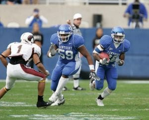 Eric Scott (59), shown blocking during his Wildcat playing days, says he will forever be indebted to UK athletics for the opportunities it gave him. (UK Athletics Photo)