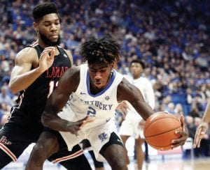 Freshman Kahlil Whitney looks for an opening in the defense of Lamar's V.J. Holmes, left, during the first half of UK's 81-56 win Sunday. For the first time Whitney is having to make a defense a priority. (Vicky Graff Photo)