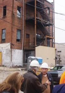 ARCHITECT BILL RICHARDSON talks with Mayor James Wiley Craft before city officials enter the Daniel Boone Hotel construction project for the first time since work began in August. (Photo by Sam Adams)