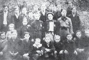 THE 1904 STUDENT BODY AT SANDLICK SCHOOL included (back row, left to right) Simeon Hale, the teacher; John Sergent, Steve Blair, Joseph Caudill, Patrick Caudill, Sam Blair, Hugh Caudill, Charlie Back, (second row) Molly Fairchild, Minta Fairchild, Lemuel Hale, Maggie Lewis, Clara Hale, Sarah Blair, George Hale, (front row) Burley Hale, Frank Caudill, Emmit Duncan, Tom Fairchild, Joe Fairchild, Roy Lewis, Willie Lewis, Robert Blair and Lewis Caudill. Molly Fairchild, now Molly Mullins of Sandlick, is the only member of the group still living. Simeon Hale, who was born in 1884, taught school for 56 years. The photo was contributed by Tom Hale, a resident of Letcher Manor in Whitesburg, who is a cousin of Simeon Hale and some of the pupils.