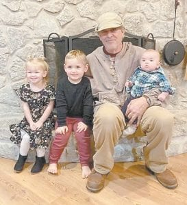 Hayward Day's son Tim Day is pictured with Tim's grandchildren, Evelyn, Jameson, and Hank.