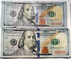 ABOVE, the Letcher County Sheriff 's Office collected a counterfeit $100 bill last week after a local resident attempted to spend it at a store here. The bogus bill is pictured at top with a real $100 bill below it.