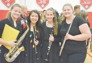 Kattelyn Nottingham (left) and Jessica Nottingham (right) are members of the Beechwood Marching Tigers Band.