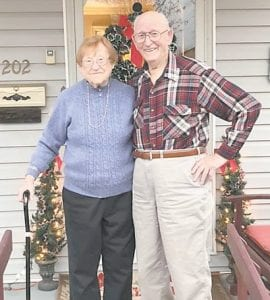 Johnny and Ann Calihan admire the beautiful work the family did in decorating the house for Christmas, just before Harrison, Ohio received about four inches of snow.