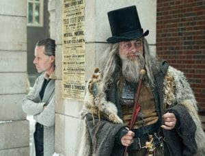 This photograph shows actors Guy Pearce as Ebenezer Scrooge, left, and Andy Serkis in character as the Spirit of Christmas Past in the movie 'A Christmas Carol.' (FX Networks via AP)