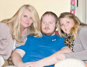 Lindy Mullins Yonts is pictured with her two children, Aaron Yonts and Allison Yonts Shuffler.