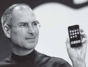 This January 9, 2007 photo shows late Apple CEO Steve Jobs (1955-2011) demonstrating the new iPhone during his keynote address at MacWorld Conference & Expo in San Francisco. (AP Photo)