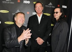 This April 18, 2013 file photo shows, from left, Alex Lifeson, Neil Peart, and Geddy Lee of Rush at the Rock and Roll Hall of Fame Induction Ceremony in Los Angeles. Peart, the renowned drummer and lyricist from the band Rush, died January 7 in Santa Monica, Calif. (AP)