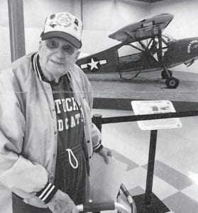 Everett Vanover stands near an L-5 aircraft, the first plane he flew in the 940s after he entered the military. The L-5 is on display at Travis Air Force Base, where he served for 13 years and recently visited with friends.