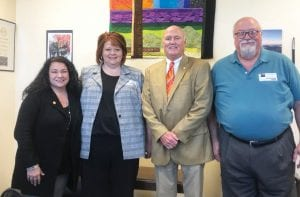 State Senator Johnny Ray Turner, second from right, announced this week that he his co-sponsoring Senate Bill 126, which would end the state mandate requiring school board members in Letcher County, Jenkins and elsewhere in Kentucky to take 12 hours of yearly training on charter schools (see story inside). Turner, of Prestonsburg, is seen here with State Rep. Angie Hatton, left, after the two met in Frankfort recently with Letcher Schools Supterintendent Denise Yonts and her husband, Rocky.