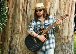 "Singer-songwriter Billy Ray Cyrus posed last week for a portrait with an Ovation guitar presented to him by Neil Diamond back in 1992. The eastern Kentucky-born singer won his first Grammy this year for his collaboration with rapper Lil Nas X on ""Old Town Road."" He released a three-song EP on January 31, ""The Singin' Hills Sessions Vol. 1 Sunset."" (AP Photo)"