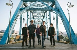 """This image released by Big Hassle shows members of Drive-By Truckers, from left, Brad Morgan, Patterson Hood, Matt Patton, Mike Cooley and Jay Gonzalez posing in front of the Walnut Street Bridge in Chattanooga, Tenn. The band's new disc, """"The Unraveling,"""" is out now. (Andy Tenille via AP)"""