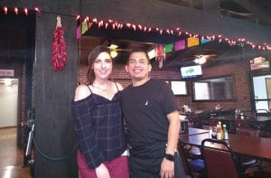 NEW RESAURATEUR – Javier Navarro and Olivia Hall stand inside Paco's Mexican Restaurant in Jenkins. Navarro worked at the restaurant when it was under the previous ownership, but now he owns the business.