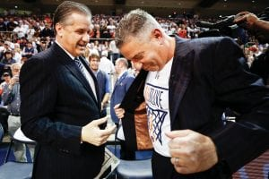 Auburn coach Bruce Pearl, right, shows his shirt to John Calipari before their game at Auburn. Pearl said he respects Calipari as well as the appreciation UK fans have for basketball. (Vicky Graff Photo)