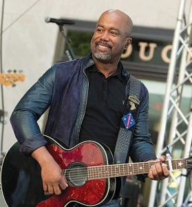 """Darius Rucker couldn't quite believe it when he was surprised with the news that his song """"Wagon Wheel"""" is now certified eight times platinum, making it one of the top five most popular country singles ever. (Invision/AP)"""